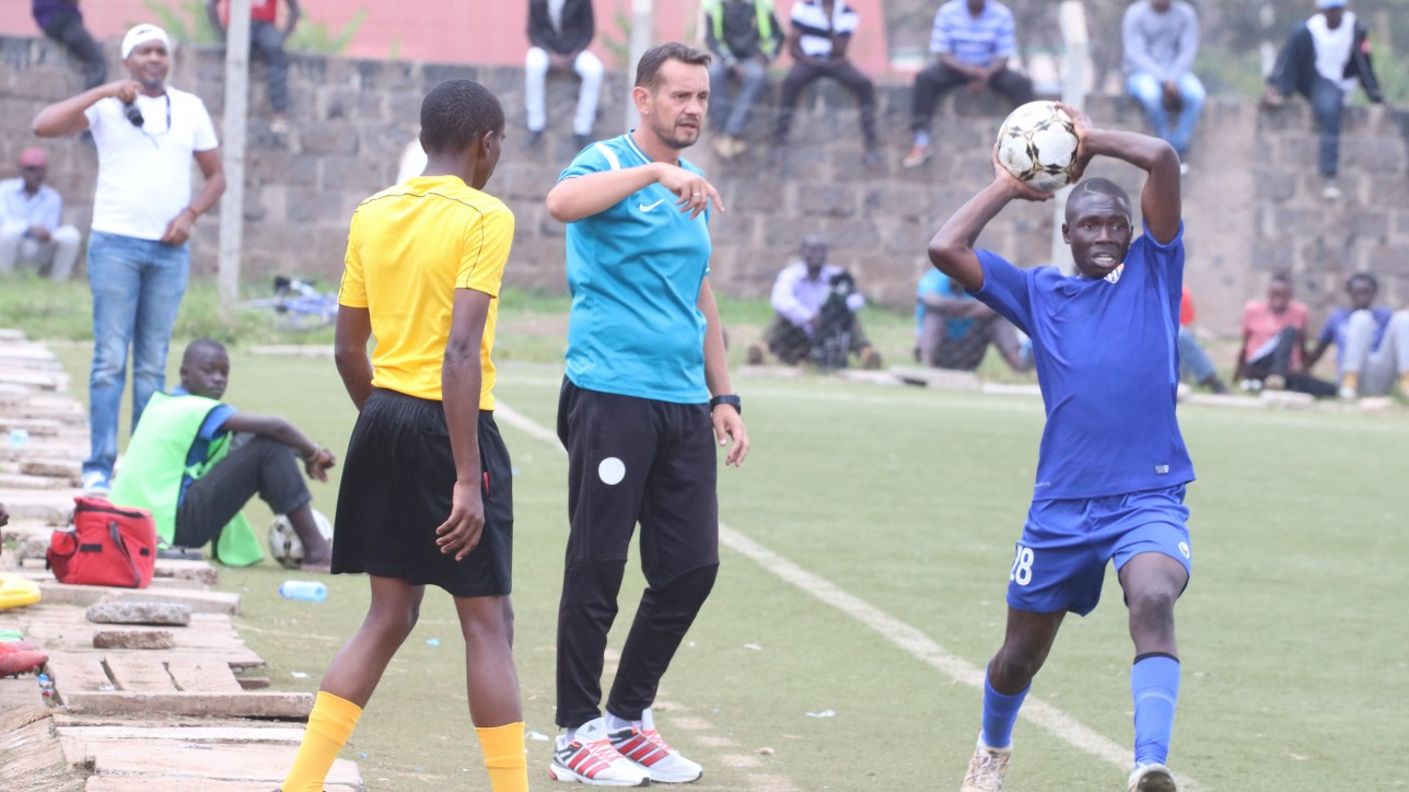 Coach Sanjin Alagic looks on as Kevin Chumsy Okumu takes a throw-in in a past game