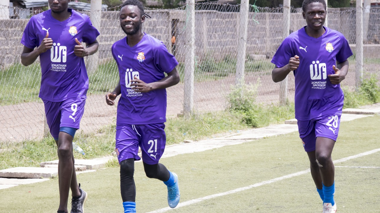 Oliver Maloba (21) with team mates Vincent Otieno (9) and Kevin Okumu (28) when he returned to training on Tue 10 Mar 2020 after a month out