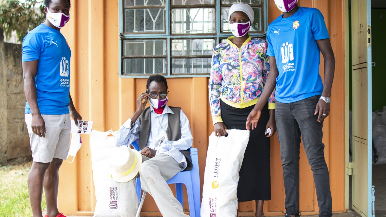 Calvin Masawa and Vincent Otieno of City Stars distributing food stuff provided by Light for the World at Dandora 44 on Tue 9 June 2020