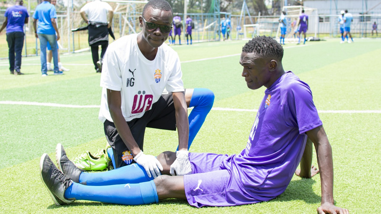 Brian Otieno Odongo is the new City Stars Physio. He attends to Sven Yidah during one of the training sessions
