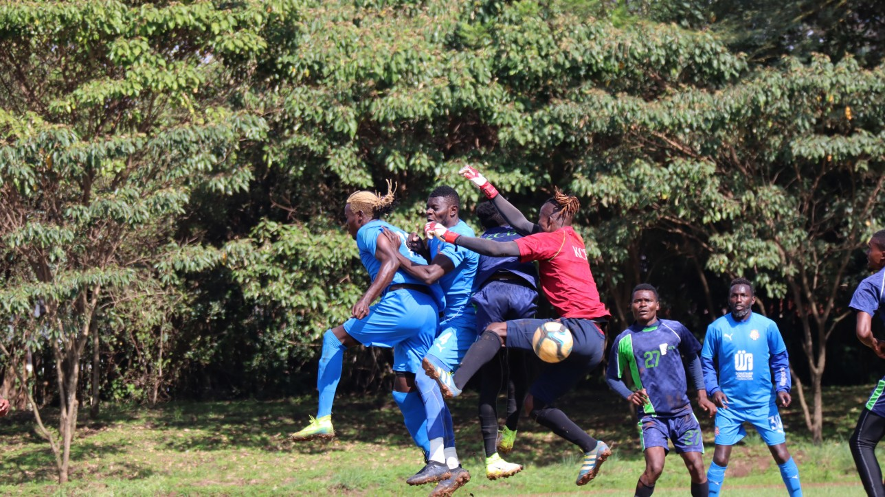 KCB keeper Gabriel Andika goes for the ball against Davis Agesa and Salim Abdallah during a friendly at Public Service Club on Wed 11 Nov 2020. KCB won 1-0
