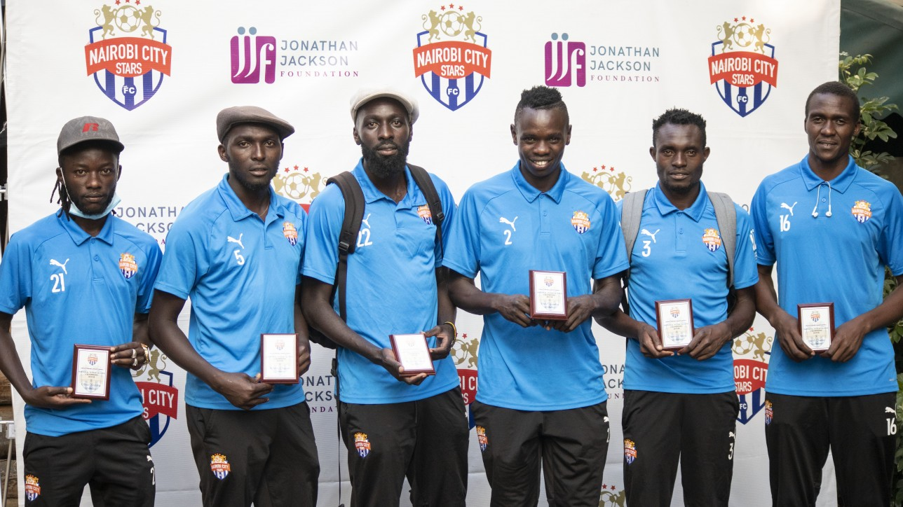 Promotion plaques on parade on Mon 21 Dec 2020 from (L to R); Oliver Maloba (21), Wesley Onguso (5), Wycliffe Otieno (22), Elvis Noor Ojiambo (2), Charles Otieno (3), Jacob Osano (16)