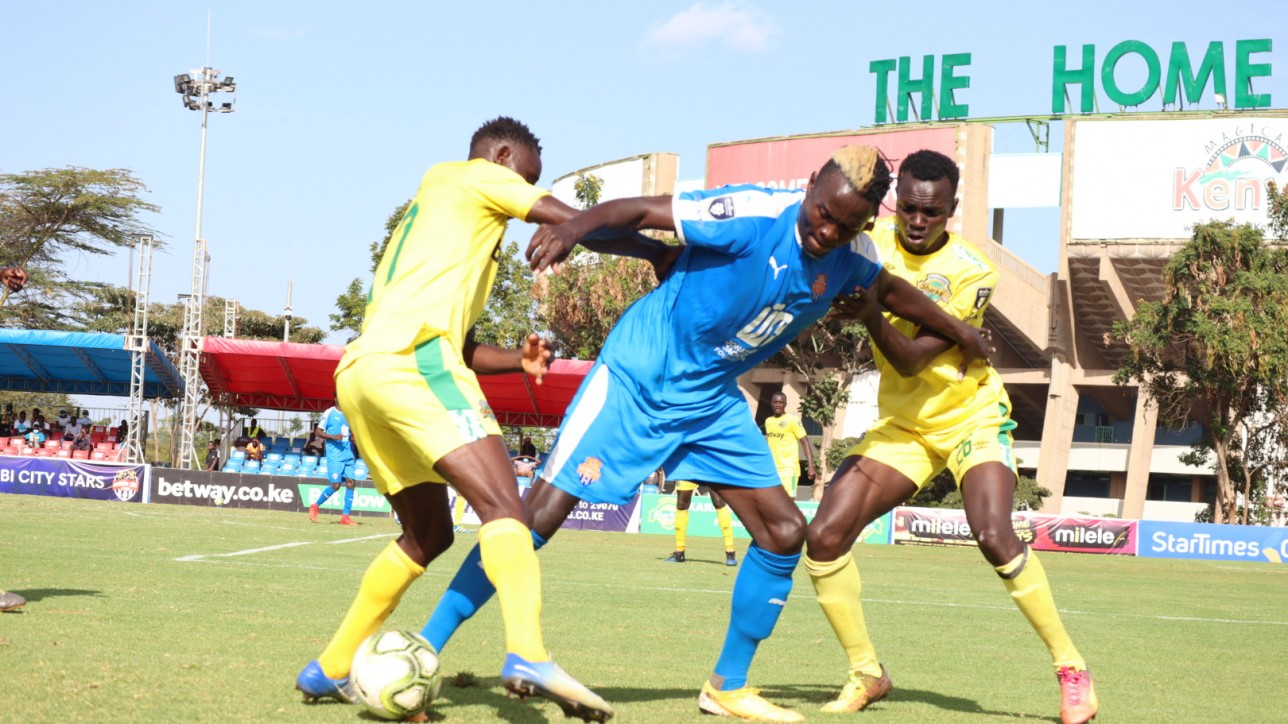City Stars striker Davis Agesa takes on two Kariobangi Sharks players at Kasarani on Sat 30 Jan 2021 during a 10th round Premier League tie. Sharks won 2-1
