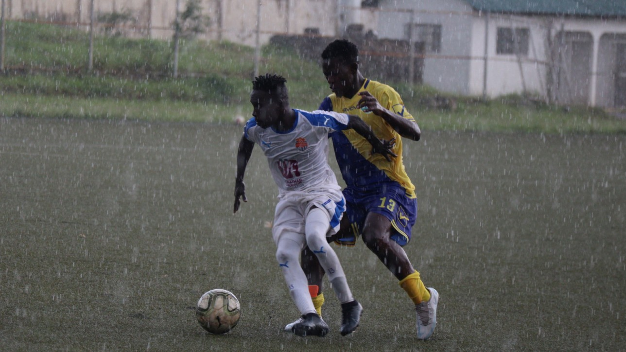 Rodgers Okumu of City Stars challenged by Geoffrey Ojunga of Western Stima during a rainy premier league game at Moi Stadium on Wed 24 Feb 2021. City Stars won 2-0