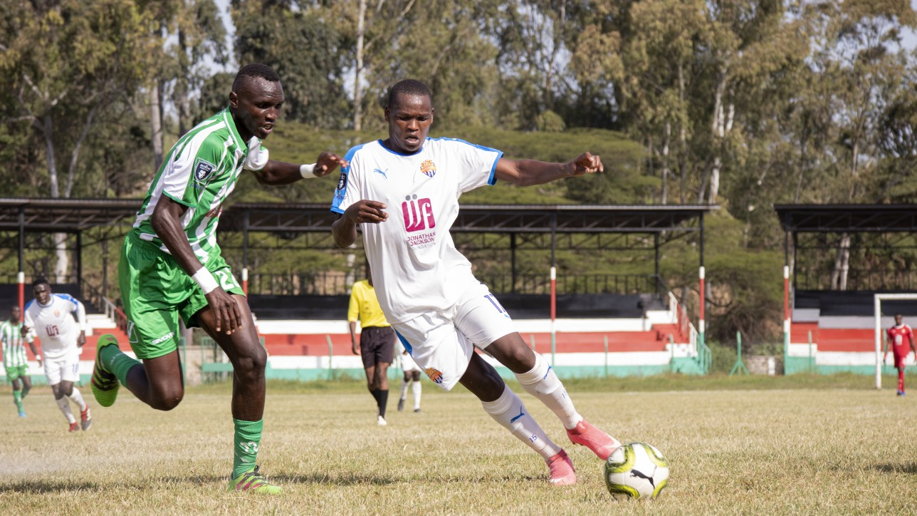 Elvis Ronack eyes the ball on Nicholas Kipkirui's during a Nzoia United - Nairobi City Stars game at Narok Stdium on Fri 25 June 2021. City Stars won it 1-0