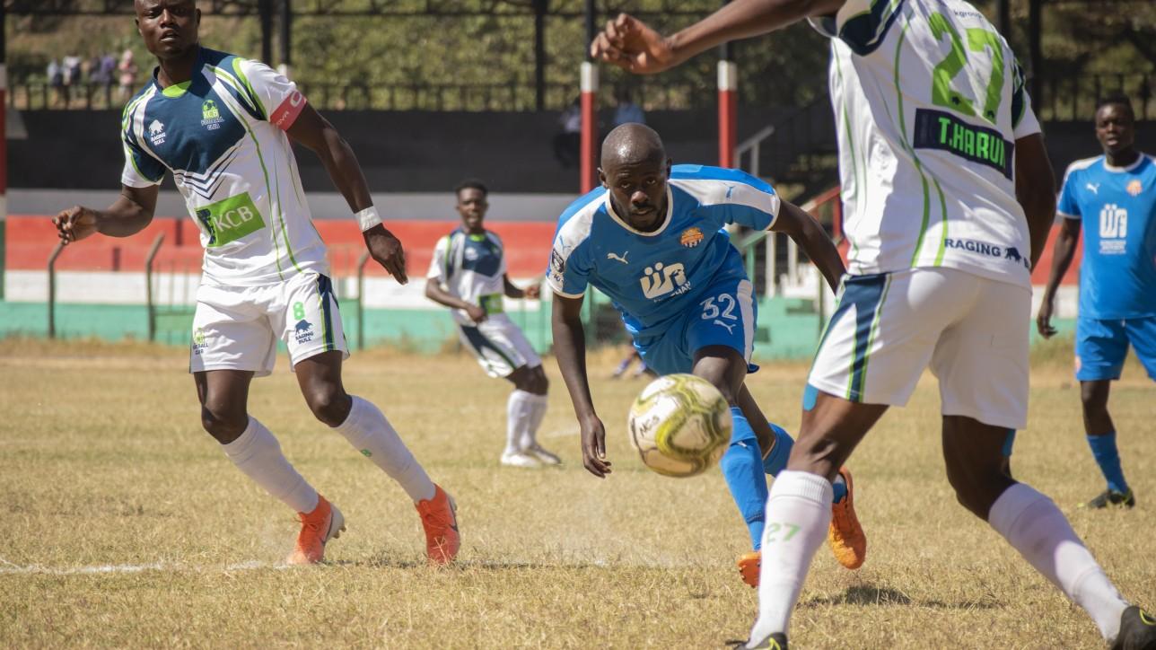 Nairobi City Stars striker Ezekiel Odera sandwiched by KCB players during the 34th and final FKF Premier League game at Narok Stadium Sun 22 Aug 2021. KCB won it 3-0