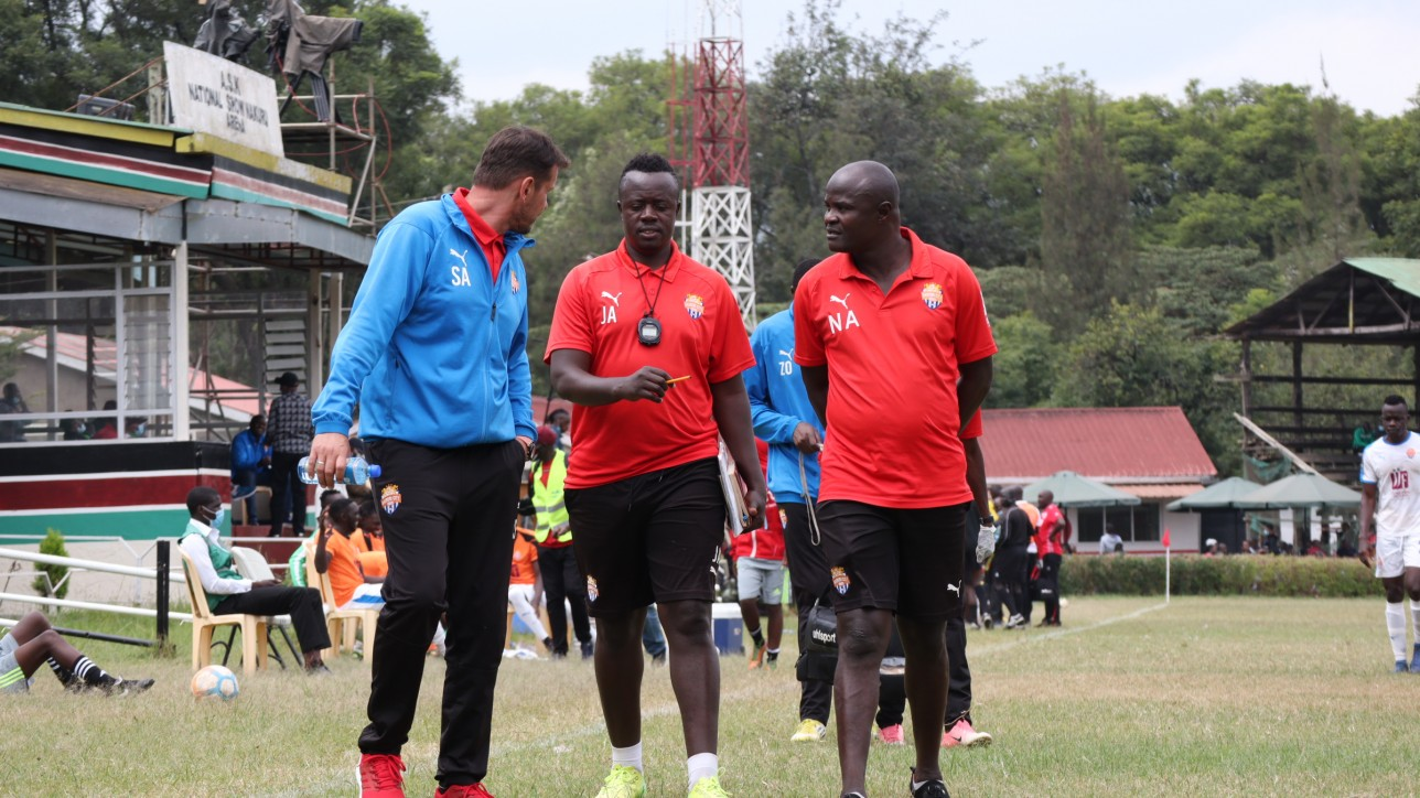 John Amboko is sandwiched by former coach Sanjin Alagic whom he took over from in mid-July 2021. To the right is assistant coach Noah Abich
