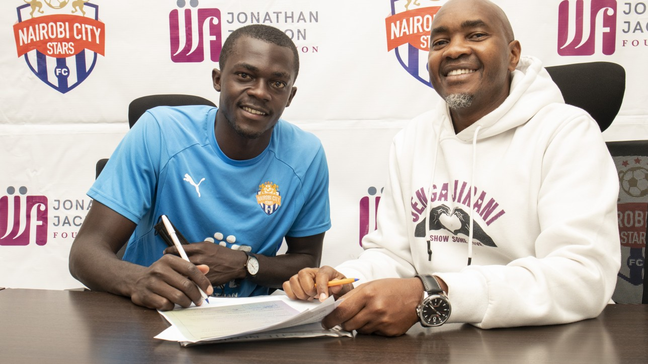 Central midfielder Lennox Ogutu completing his paperwork at Nairobi City Stars